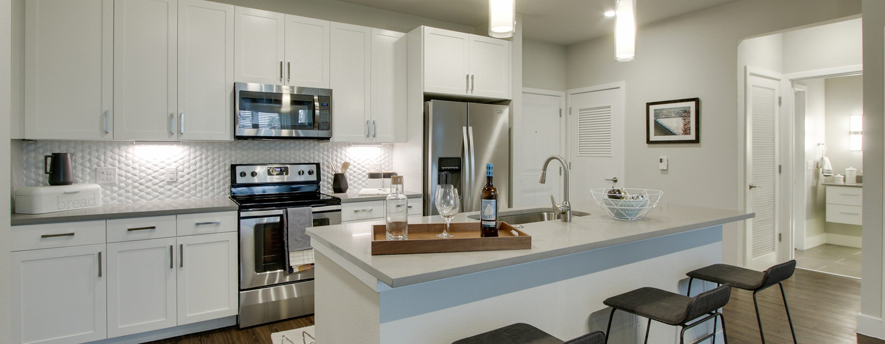 large kitchen with overhead lighting