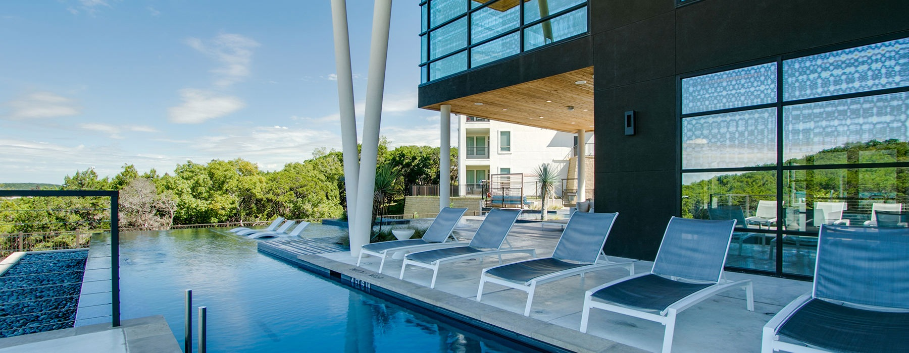 pool with lounge chairs and views
